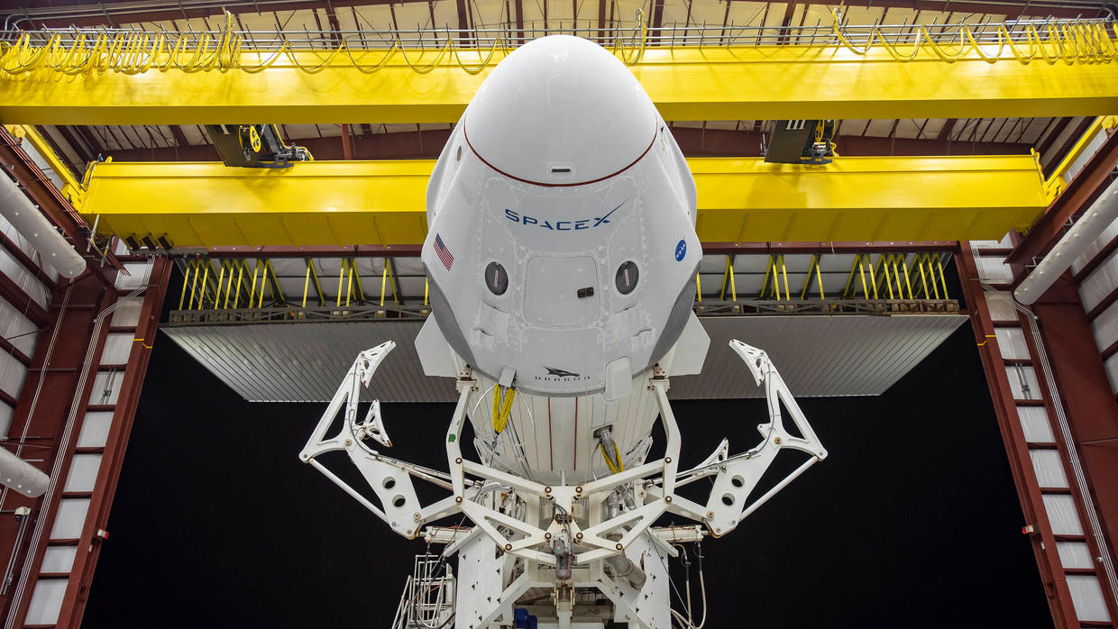 Photo of SpaceX Dragon capsule docks with International Space Station