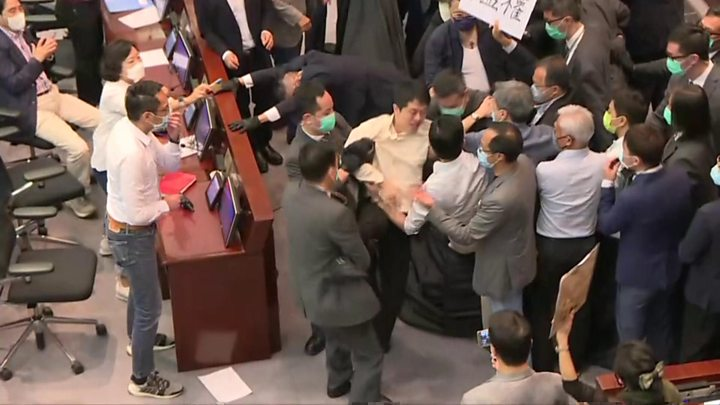 Photo of Hong Kong: Lawmakers carried out during parliament mayhem