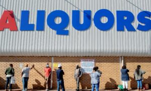 Photo of South Africa Eases Restrictions; Liquor Is Sold, School Openings Delayed