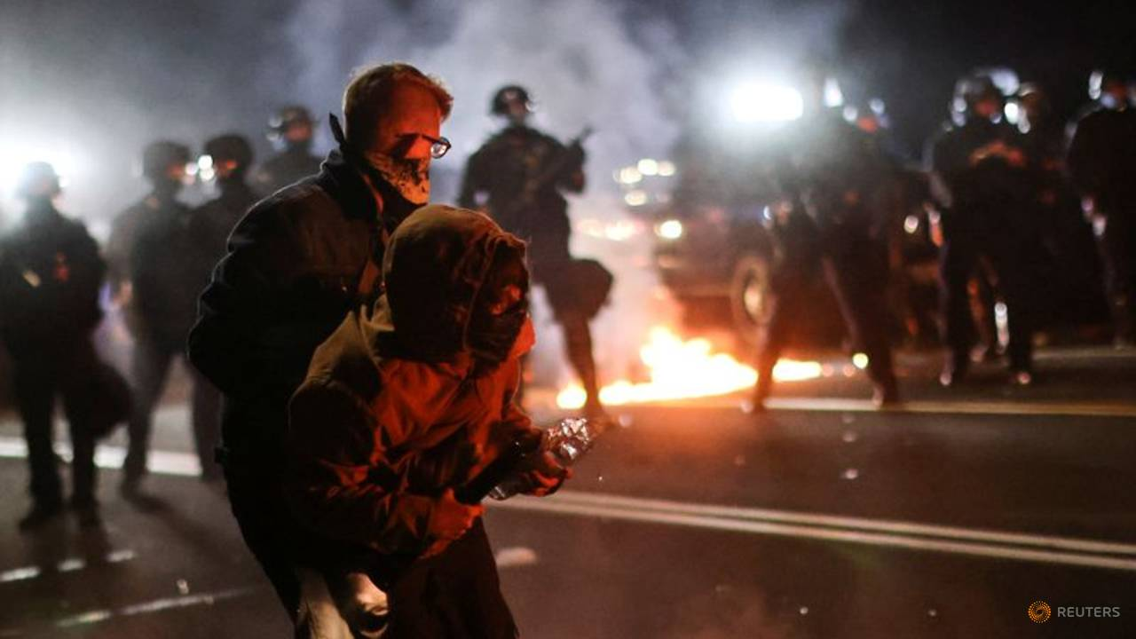 Photo of Tear gas, fire bombs as police declare Portland protest a 'riot'