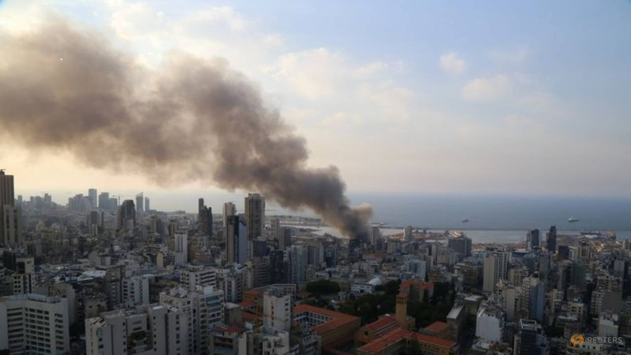 Photo of Lebanese firefighters douse remains of Beirut port fire