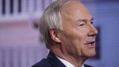 Photo of Arkansas governor signs bill banning nearly all abortions in pro-life advocates' latest move to overturn Roe v Wade